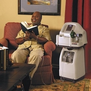 man reading book beside home fill oxygen station